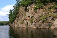 Northern rock wall shoreline Royalty Free Stock Photo