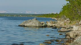 Northern russian landscape - Imandra lake with rocks on the shore Stock Images