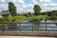 Northern Russian Village By The River Stock Photos