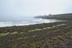 Northern Schelde. Gloomy foggy morning at the Northern Schelde. The Netherlands Royalty Free Stock Images