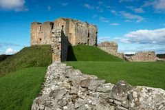 Ruins of Duffus Castle, Scotland. In northern Scotland the ruins of a 12c castle is a tourist attraction adjacent to the Speyside Whisky Trail Royalty Free Stock Photo