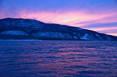 Northern, Siberian river in the winter. The river. A winter landscape. Ice, water. A river coast Stock Photography