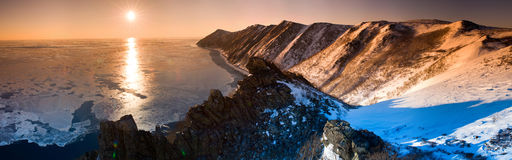 Northern sphinx. Panorama of mountain range extends into the open sea at sunset Stock Photography