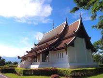 Northern Thai art church under blue sky. Northern-styled Thai art in public church under blue sky, Chiangrai, Thailand Stock Images