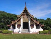 Northern Thai art church under blue sky. Northern-styled Thai art in public church under blue sky, Chiangrai, Thailand Royalty Free Stock Images