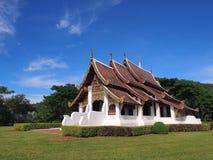 Northern Thai art church under blue sky. Northern-styled Thai art in public church under blue sky, Chiangrai, Thailand Stock Image