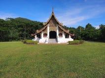 Northern Thai art church under blue sky. Northern-styled Thai art in public church under blue sky, Chiangrai, Thailand Royalty Free Stock Image