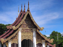 Northern Thai art church under blue sky. Northern-styled Thai art in public church under blue sky, Chiangrai, Thailand Stock Photography
