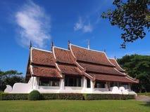 Northern Thai art church under blue sky. Northern-styled Thai art in public church under blue sky, Chiangrai, Thailand Stock Photo