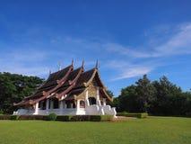Northern Thai art church under blue sky. Northern-styled Thai art in public church under blue sky, Chiangrai, Thailand Stock Photos
