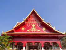 Northern Thai art roof in temple under blue sky Stock Images