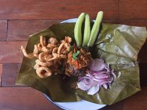 Northern Thai food. Steamed rice serve with vegetable fried pork skin and fried onion Royalty Free Stock Photography