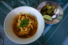 Northern Thai Noodle Curry Soup in bowl serve with lemon , onion. And pickle vegetable put on the table, Selective focus royalty free stock images