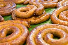 Northern Thai sausage on banana leaves at Tung Kwian Market,. Lampang, Thailand Stock Photo