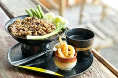 Northern Thai Spicy minced pork salad or `Larb Kua` with rice. The delicious Northern food style in Thailand. On wooden table stock photo