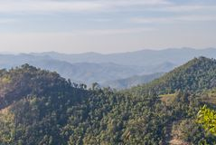 Northern Thailand hills. The view over hills and terraces in northern Thailand around Chiang Mai landscape nature mountain travel sky green rural tree royalty free stock images