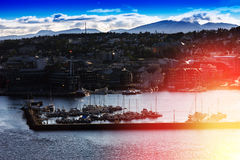 Northern Tromso city port with light leak background Royalty Free Stock Photos