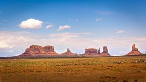 Northern View of Monument Valley. View of Monument Valley from north; from left to right Saddleback, King on His Throne, Stagecoach, Bear and Rabbit, Castle Rock Royalty Free Stock Images