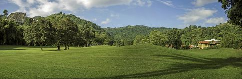 A northern view of St. Andrew`s Golf Course in Trinidad. Lying in the heart of the Northern Range in the Maraval Valley, is the St. Andrew`s Golf Course with its Stock Images