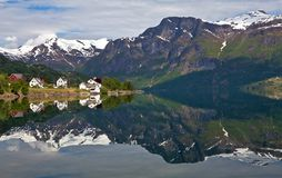 Northern village by the lake. Norway, the northern village Oppstryun, car photo tour around the country Stock Photo