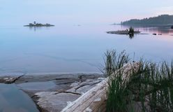 Northern White Night Over The Rocky Islands In The Lake Royalty Free Stock Photos