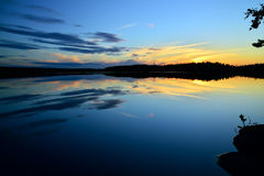 Northern white nights on the lake Pongoma. Karelia, Russia Stock Images