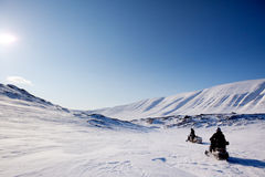 Northern Winter Landsacpe. Two snowmobiles on a barren winter landscape, Svalbard Norway Stock Photography