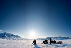 Northern Winter Landsacpe. Three snowmobiles on a beautiful winter landscape Royalty Free Stock Image