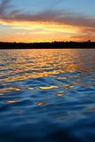 Northern Wisconsin Lake Sunset. Sunlight reflects off ripples of Sweeney Lake in Wisconsin royalty free stock images