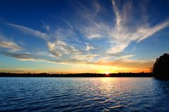 Northern Wisconsin Lake Sunset. Sunlight reflects off ripples of Sweeney Lake in Wisconsin Stock Image