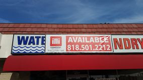 Northidge, CA / United States - April 1 2019: Closed-down out of business coin laudromat and water store royalty free stock images