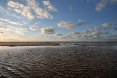 Northsea coast. Little clouds against a blue sky above the northsea coast of holland Stock Image