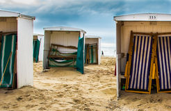 Northsea, Dutch retro Woodenbeach chairs in the morning. Northsea, Dutch retro wooden beach chairs in the morning Royalty Free Stock Photography