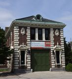 Northside Firehouse. This is a Summer picture of a former firehouse located on the Northside of Chicago, Illinois in Cook County.  This brick structure was built Stock Photo