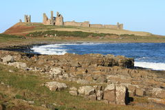 Northumberland coast with Dunstanburgh castle in background Royalty Free Stock Photography
