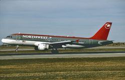 Northwest Airlines Airbus A320 landing at Minneapolis after a flight from Miami `1995. Northwest International Airlines Airbus A320 landing at Minneapolis after Royalty Free Stock Image