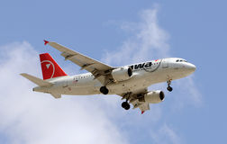 Northwest Airlines airplane in flight Stock Photo