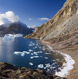 Northwest Fjord in Greenland. Ice on the shore of a small inlet in Northwest Fjord in the far reaches of Scoresbysund in eastern Greenland Stock Photo