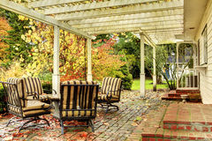 Northwest horse ranch white house with fall changing leaves and white fence. stock photography