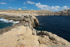 Coast of the island of Gozo Malta. Northwestern coast of the island of Gozo Malta, Dwejra Tower Royalty Free Stock Photography