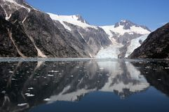Northwestern Glacier. Alaskan Glacier Reflects Onto Water Stock Photography