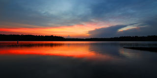 Northwoods Wisconsin Sunset. Brilliant colors of sunset over Buffalo Lake in the Northern Highland American Legion State Forest of Wisconsin stock photography