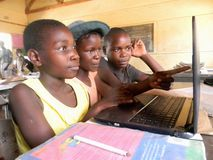 Close-up of schoolgirls using a laptop in class royalty free stock photography