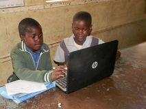 African kids using HP laptop. Norton,Zimbabwe,4 October 2017. Two African primary school children learning how use a laptop inside a classroom at school.Use of stock image