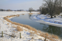 Norttawasga River in Winter. A curve in the Nottawasaga River in early January. Fresh fallen snow is in the fields Stock Images