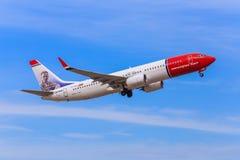 norvegese COM scaturisce decolla Fotografie Stock