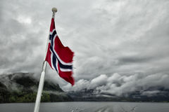 Norvegian flag. With the fjord in background in Bergen, Norway Royalty Free Stock Image