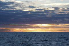 Norvegian sea sunset. Sunset in norvegian sea, coast, from a cruise boat, Norway Royalty Free Stock Image