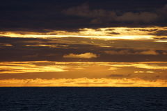 Norvegian sea sunset. Sunset in norvegian sea, coast, from a cruise boat, Norway Stock Photos