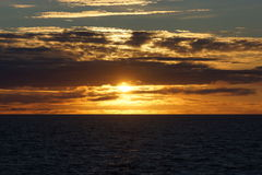 Norvegian sea sunset. Sunset in norvegian sea, coast, from a cruise boat, Norway Stock Image